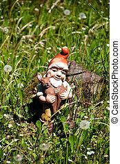Garden Dwarf - Old plastic garden dwarf (gnome) carrying a ...