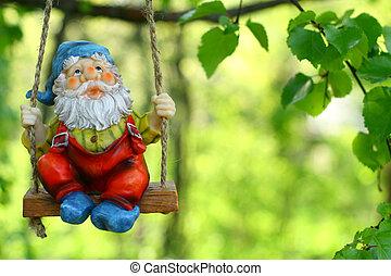 garden dwarf on green background