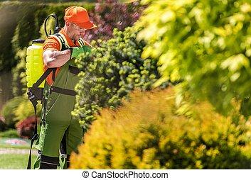 Garden Fertilizer Equipment - Caucasian Gardener in His 30s...