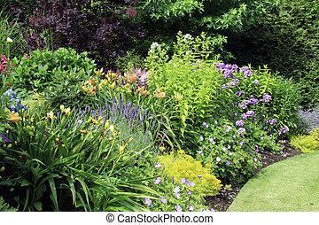 Garden flower bed - Perennial flower bed in summer.