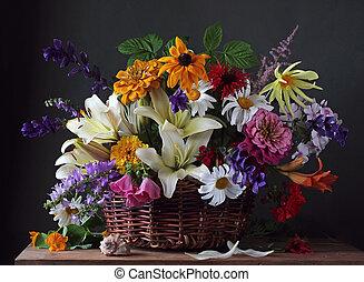 Garden flowers in the basket. Still life.