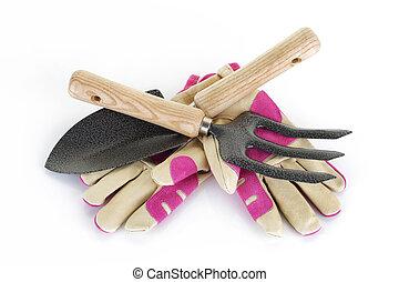 Garden fork trowel and gloves on white