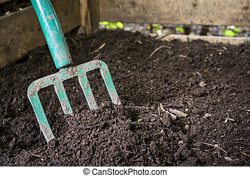 Garden fork turning compost - Garden fork turning black...