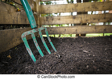 Garden fork turning compost