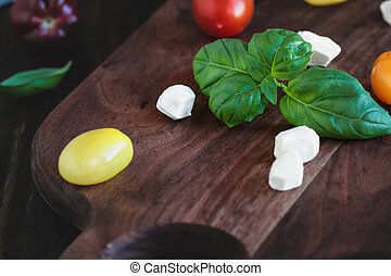Garden Fresh Basil and Heirloom Tomatoes with Mozzarella Cheese for Caprese Salad