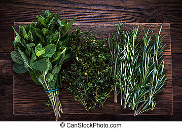 Garden fresh herbs on wooden board