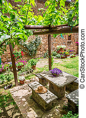 Garden full of flowers and vines in Tuscany