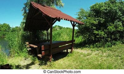 Garden furniture on bank of river
