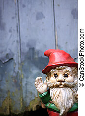 Garden Gnome - A small bearded garden gnome waving his hand....
