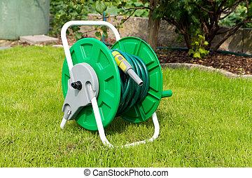Garden hose - wrapped garden hose in a garden