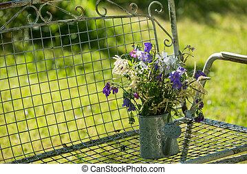 Garden idyll - Garden flowers on a garden bench