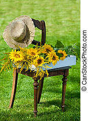 Garden idyll with sunflowers on a chair