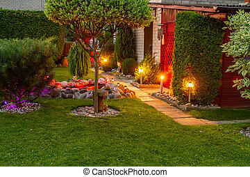 Garden illuminated by color lamps