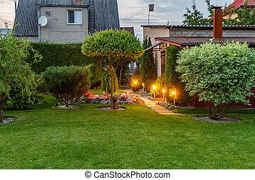 Garden illuminated by lamps in my yard