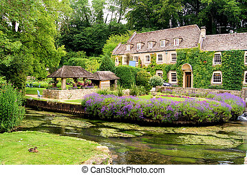 Garden in the Cotswolds, England - Picturesque garden in the...