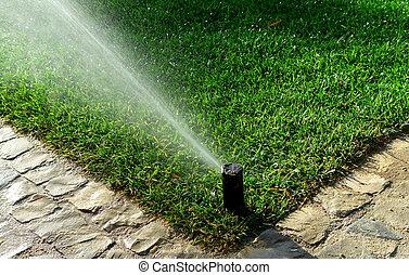 Garden irrigation system watering lawn...