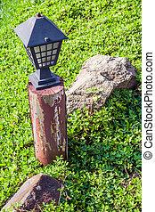 Garden lamp in morning sunlight