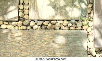 garden landscape paving design. pebble stones and wood plank...