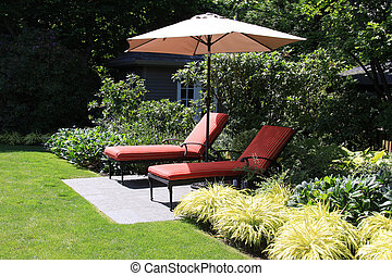 Garden lounge chairs with umbrella.