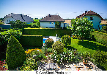 garden of a detached - the garden with a swimming pool of a...