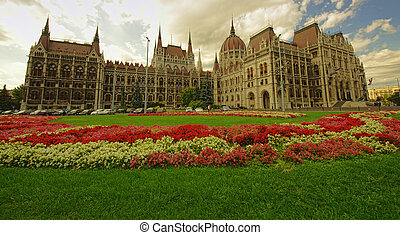 garden of Budapest city Parliament full of flowers. wide view