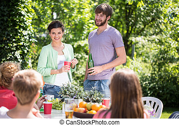 Garden party at summer time - Friends having garden party at...