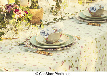 Garden party setting - Image of table setting for wedding or...