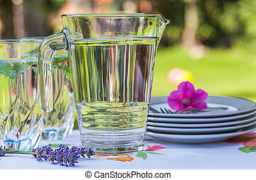 Garden party - Table with cool drinks and plates for party