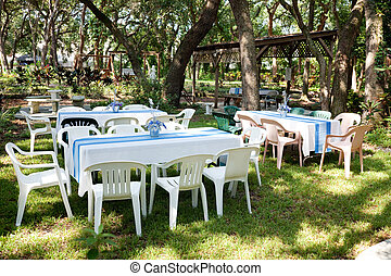 Garden Party - Tables and chairs set up for a garden party,...