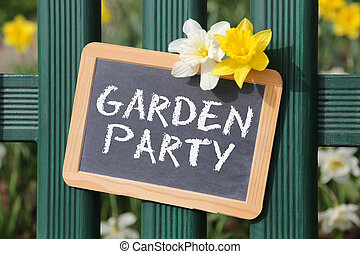 Garden party with flowers flower sign board on fence