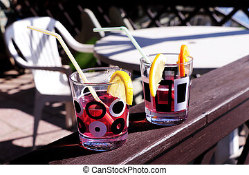 Garden party with good drinks. Coctail with lemon and straw....