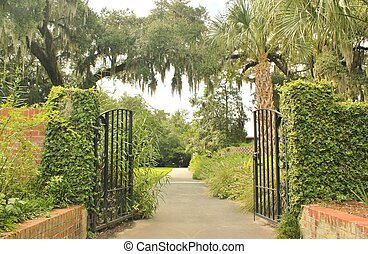 Wrought iron gates provides an entrance to beautiful gardens