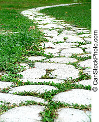 Garden path - Garden stone path with grass growing up...