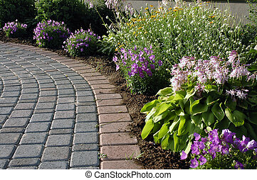 Garden Path - Interlocking stone walk with flower bed