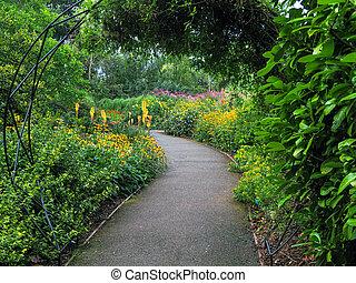 Garden path through mixed flower borders