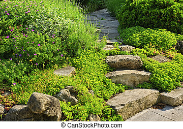 Garden path with stone landscaping - Natural stone steps and...