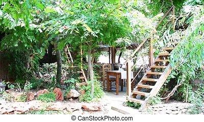 Garden Patio - Ornamental garden with wooden patio.