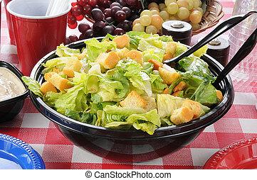 Garden salad on a picnic table