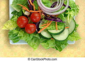 Garden salad on a square white plate.