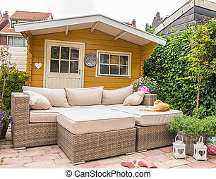 Garden shed and sofa