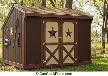 garden shed - small garden storage shed in a suburban back...
