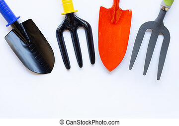 Garden shovel and fork isolated on white background