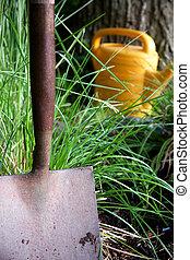 Garden shovel - Close up of garden shovel with wateing can...