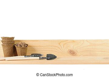 Garden shovels on wooden board