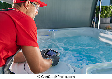 Garden SPA Technician Testing Hot Tub Remote