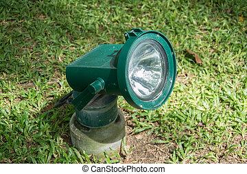 garden spotlight on green grass