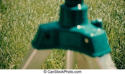Garden sprinkler on tripod Vintage footage - Vintage footage...