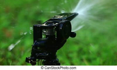 Garden sprinkler. Selective focus. Colorfull - Close-up on a...