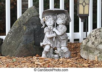 Garden statue of two children