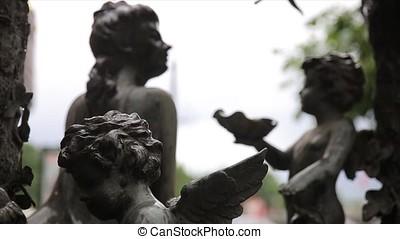 Garden statue vintage close-up. Sleeping Angel at La Recoleta Cemetery in Buenos Aires. Garden sculpture. Cupid sculpture. Sculpture of Angel at a Prague cemetery. Statue